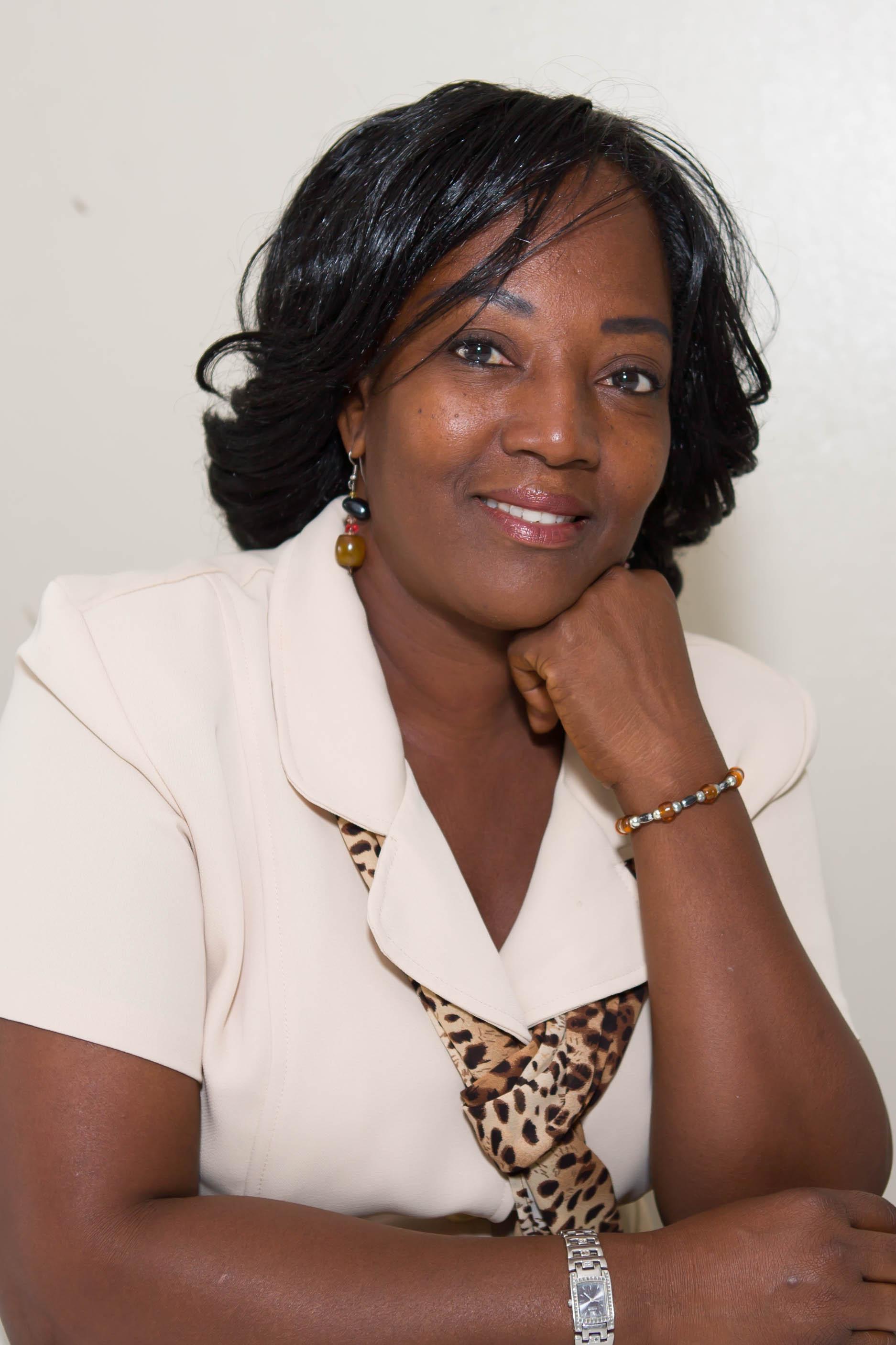 Olga Clarke : Administrative Dean/Teacher